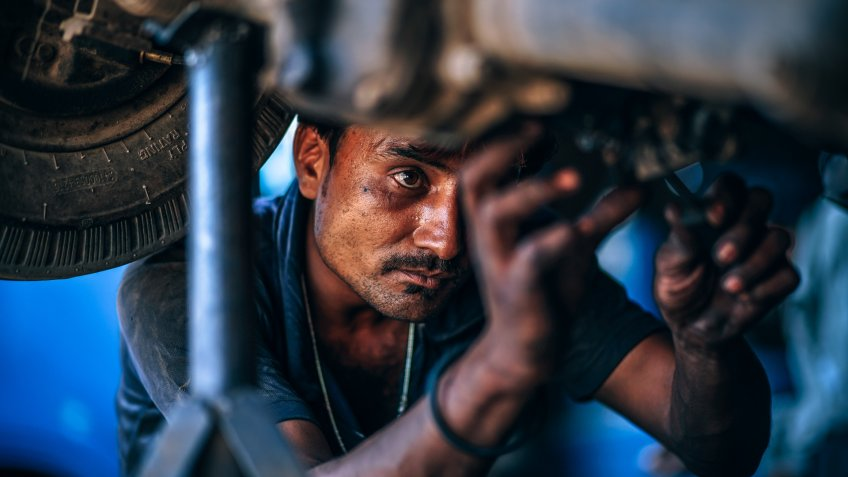 auto mechanic repairing a car