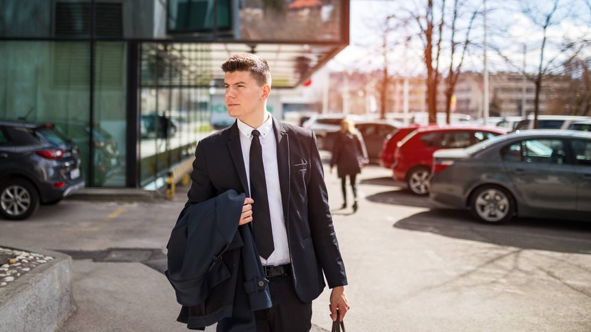 businessman leaving his work for good after quitting