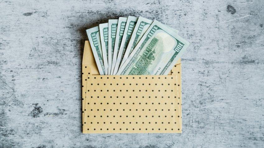 envelope with one hundred dollars bills