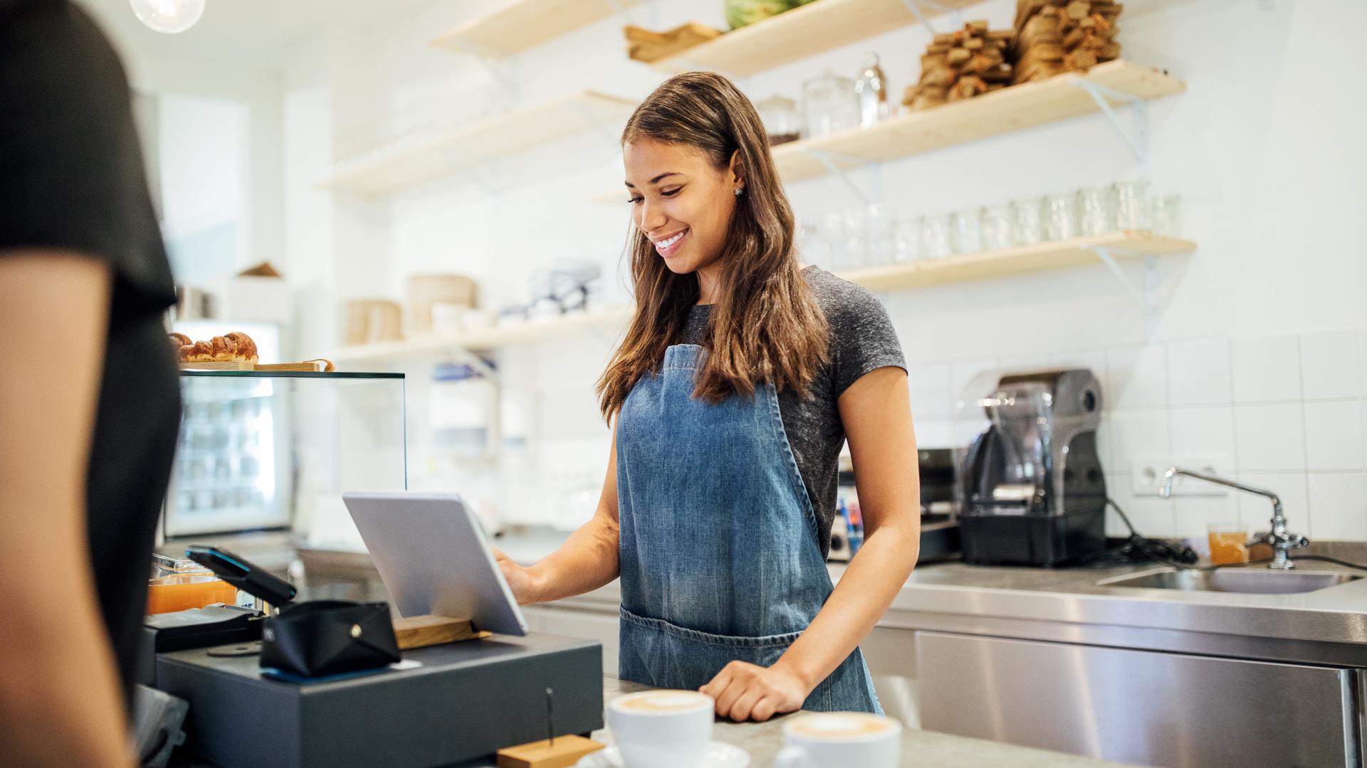 female cashier taking customer order