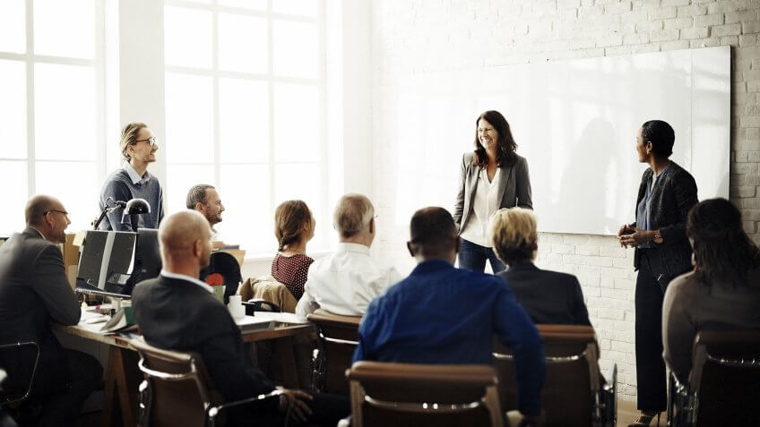female company leader giving all-hands presentation