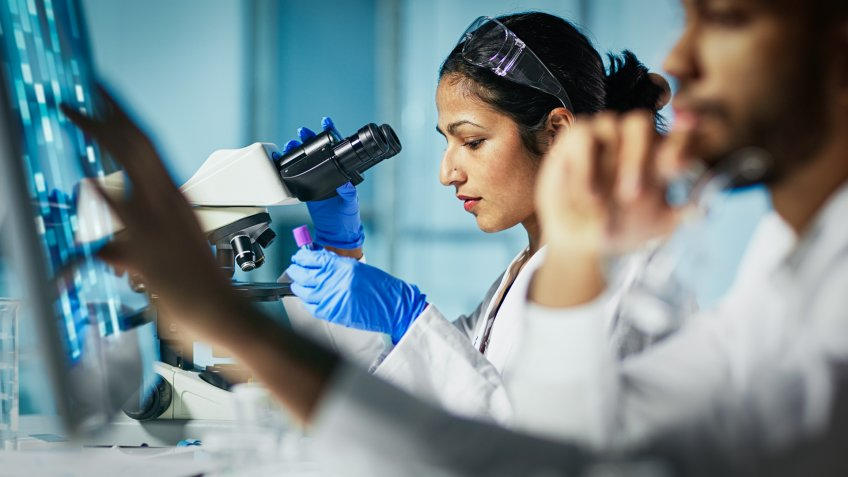 female lab technician working with male lab technician