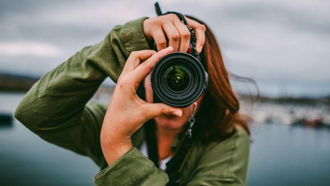 female photographer taking stock photographs