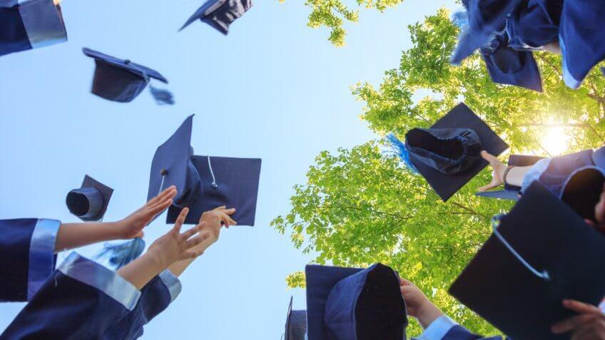 Throwing graduation hats.