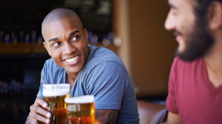 A cropped shot of young friends having drinks in a barhttp://195.