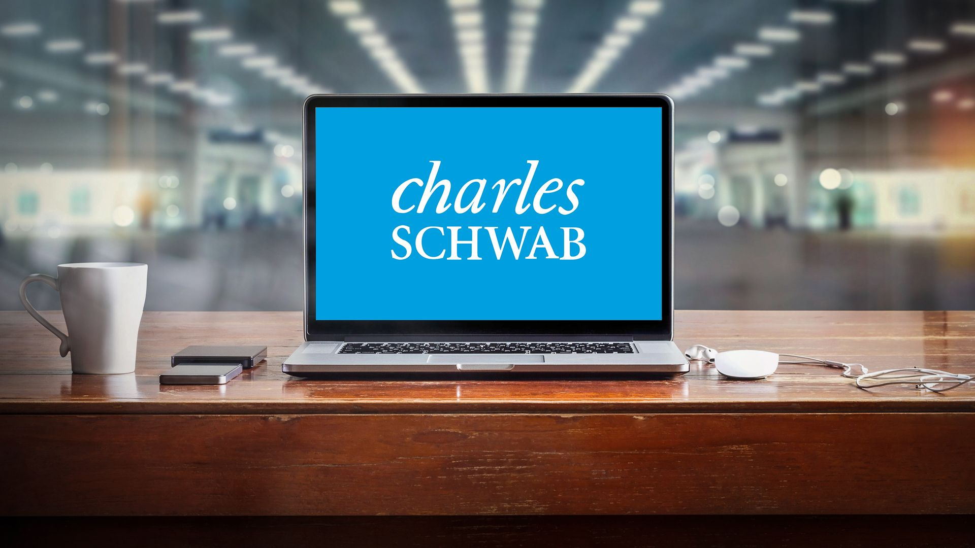 laptop screen with Charles Schwab Bank login website