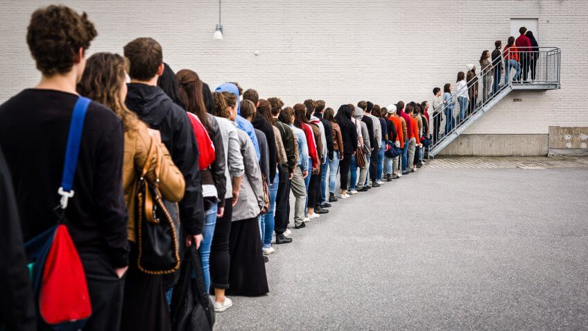 large group of people waiting in line for retirement