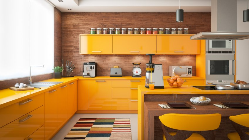 Digitally generated contemporary domestic kitchen with wooden elements, a large window with blinds on the left and the kitchen island with induction hob on the right.