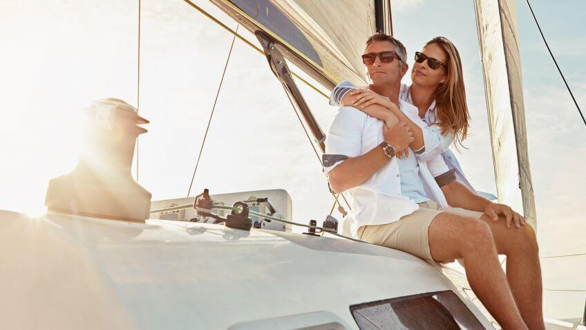 rich top earners riding on luxury yacht