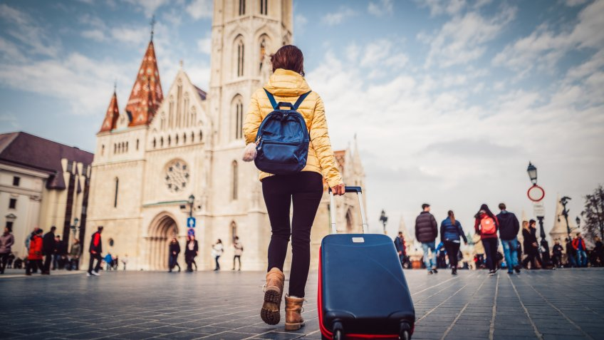 Young woman with suitcase at the castle hill-budapest.