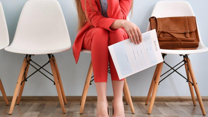 woman with her resume in waiting room