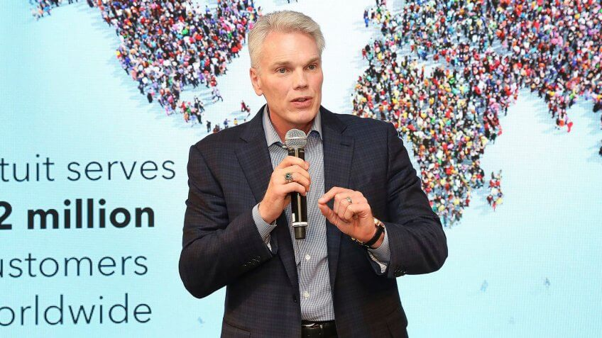 Brad Smith addresses attendees gathered at Intuit's gallery walk event in New York