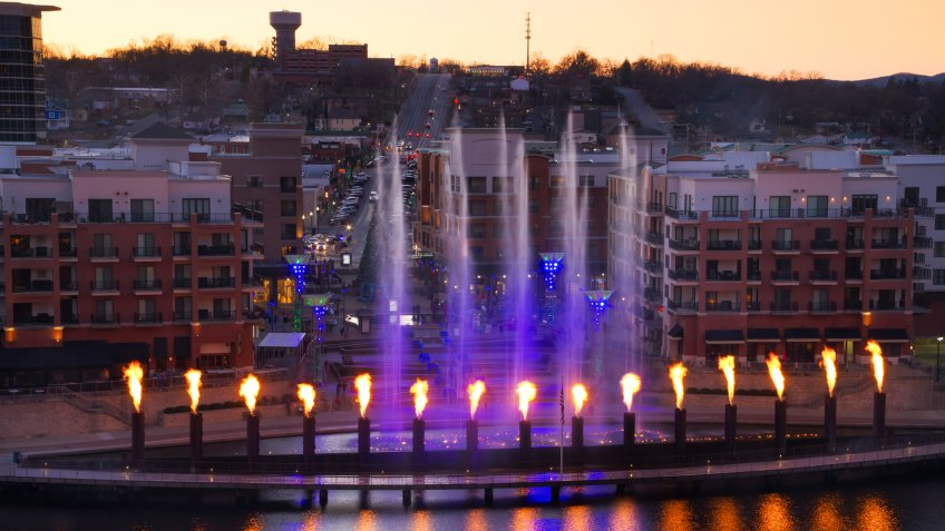Skyline view of Branson, Missouri with the display showing at the landing waterfront park area.