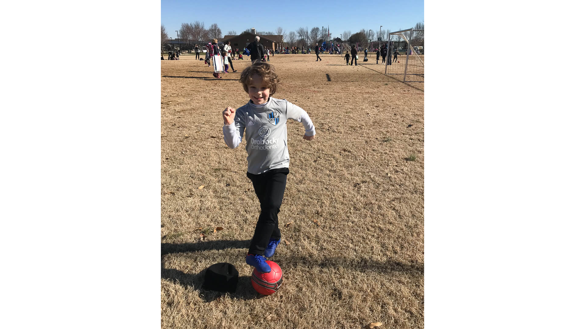 Cameron Huddleston son playing soccer in the park