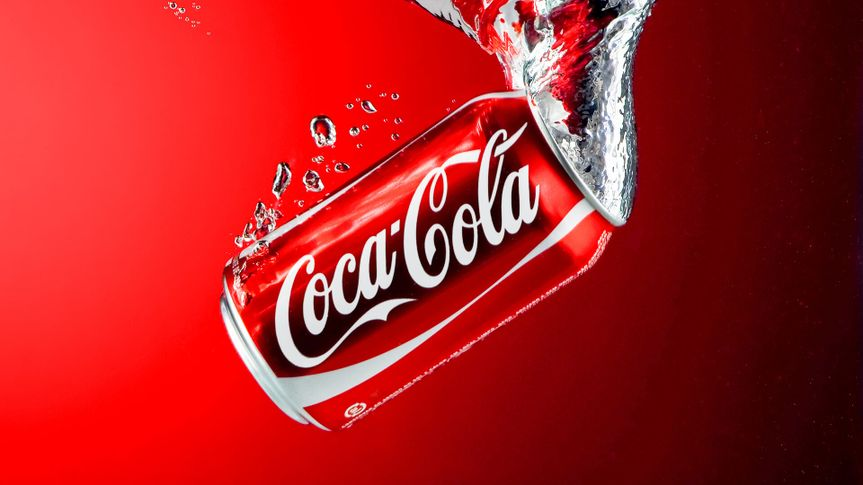 Coca-Cola can dropped in water