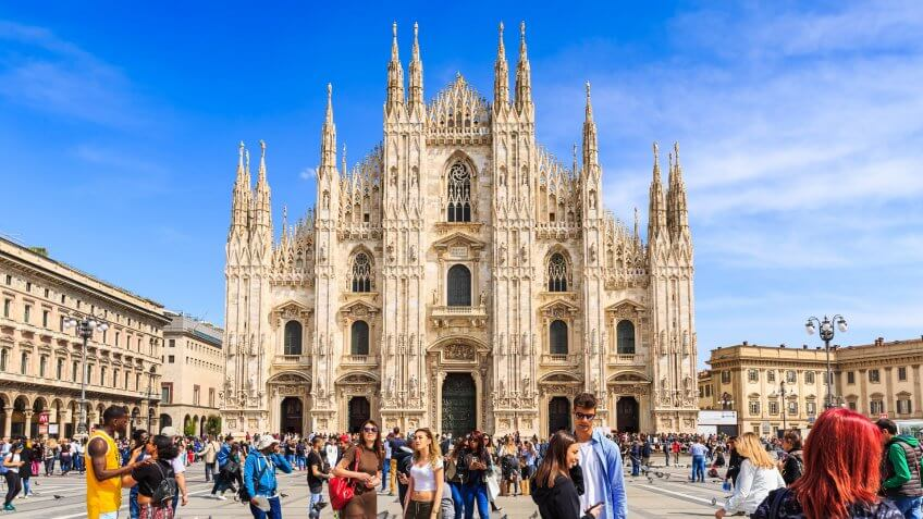 Milan, Italy - 14 April 2018 - Milan Cathedral or Duomo di Milano in Italian and crowd of tourists come to visit during daytime.