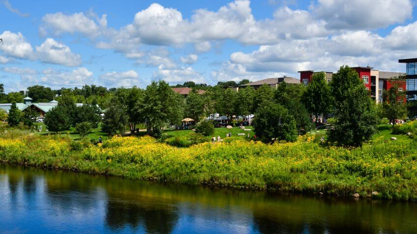 View of the farmers market and Phoenix Park along the Chippewa River in Eau Claire, Wisconsin - Image.