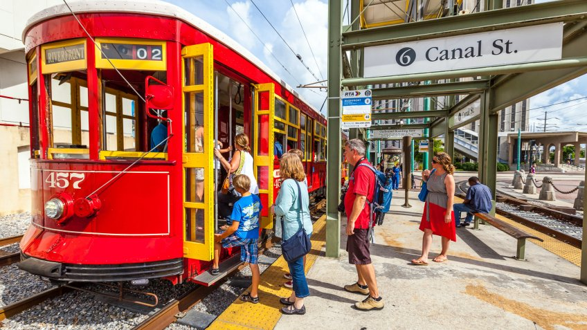 New Orleans, USA - July 16, 2013:  people enter  the riverfront  Streetcar Line in New Orleans, USA.