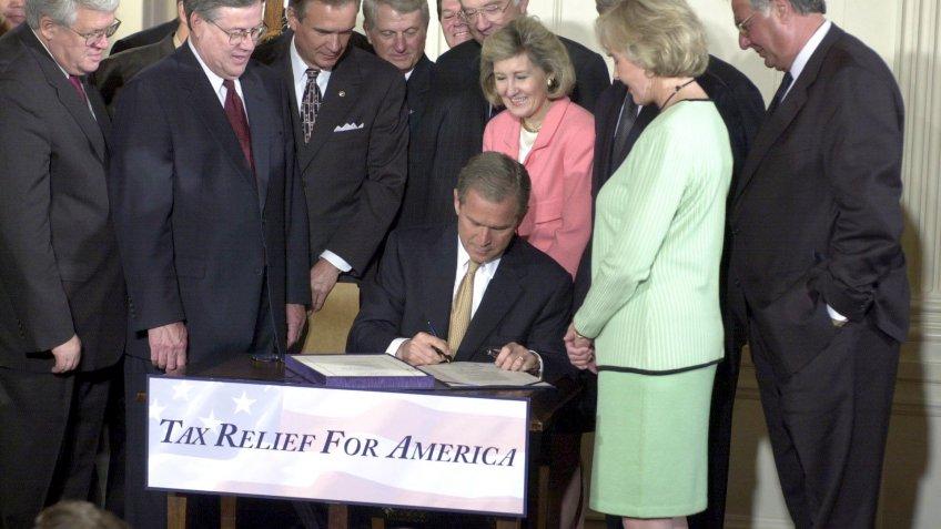 former American president George W. Bush signs $1.35 trillion tax cut bill