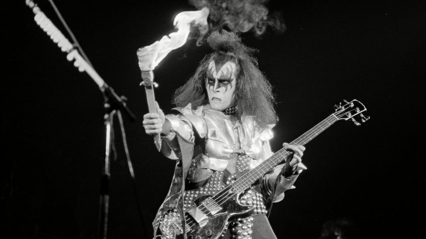 "Gene Simmons, bass guitarist for Kiss, gets ready to breathe fire during the crescendo of ""Firehouse,"" a number performed during a concert in Hartford"