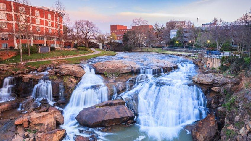 Reedy River Waterfalls run through the middle of downtown Greenville, South Carolina at Falls Park River Walk.