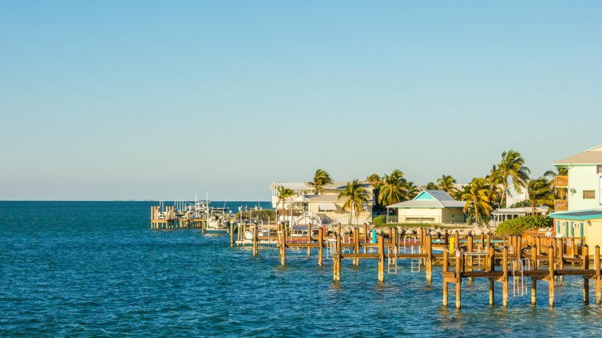 Florida Keys fishing boats in turquoise tropical blue water.