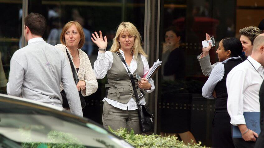 Lehman Brothers employees leaving the Canary Wharf building after the bank filed for bankruptcy