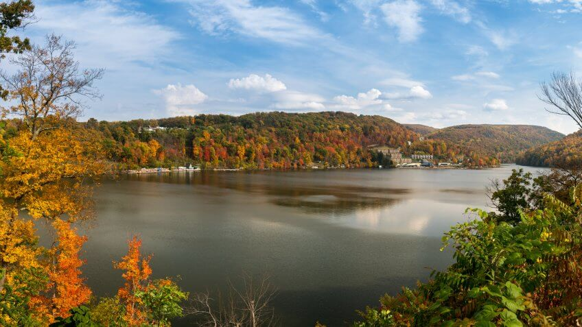 Panorama of the autumn fall colors surrounding Cheat Lake near Morgantown, West Virginia.