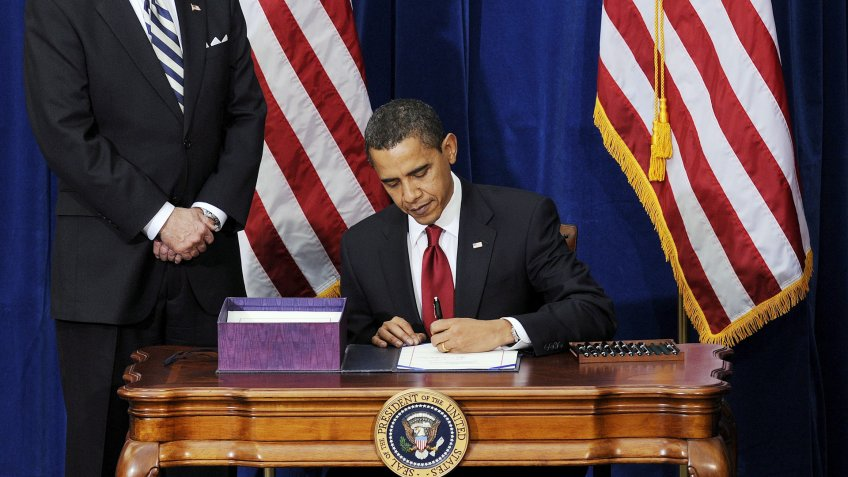 President Barack Obama signs the American Recover and Reinvestment Act Bill in February 2009