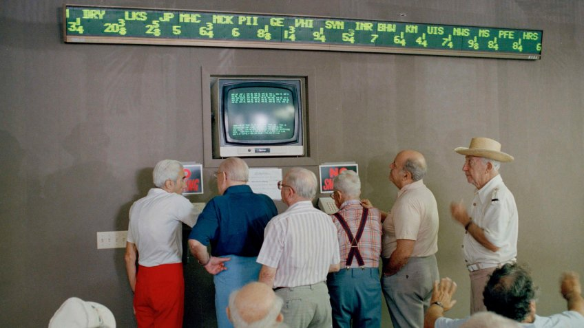 Senior citizens keep an eye on stock market prices after market collapse in 1987