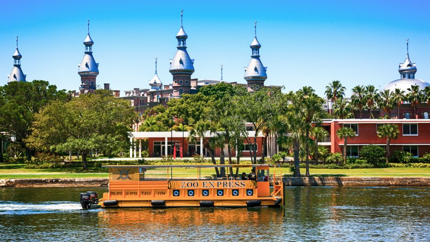 People on-board the Zoo Express water-taxi passes the University of Tampa, Florida.