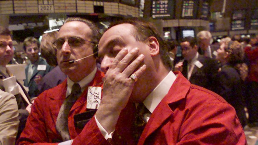 Traders looking at New York Stock Exchange boards in the year 2000