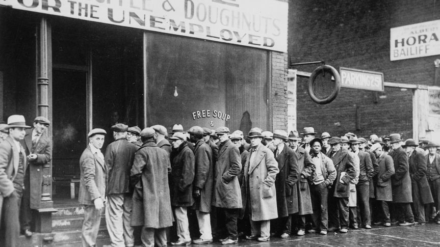 Unemployed men queued outside a depression soup kitchen opened in Chicago by Al Capone