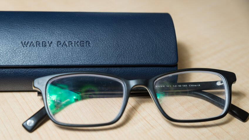 Hoboken NJ - February 5 2019: A pair of Warby Parker Wilkie glasses are shown with their case.
