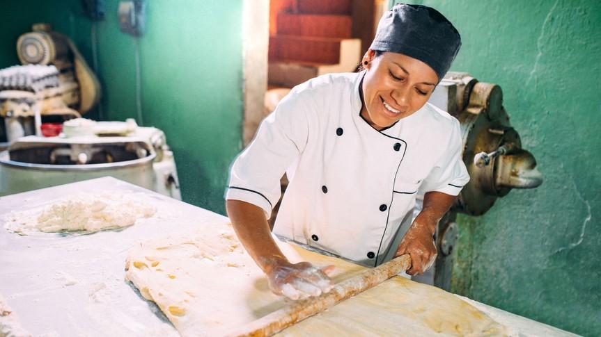 Baker kneading pastry dough.