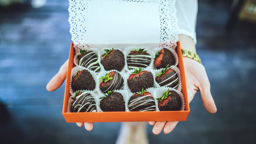 chocolate covered strawberries in a red box