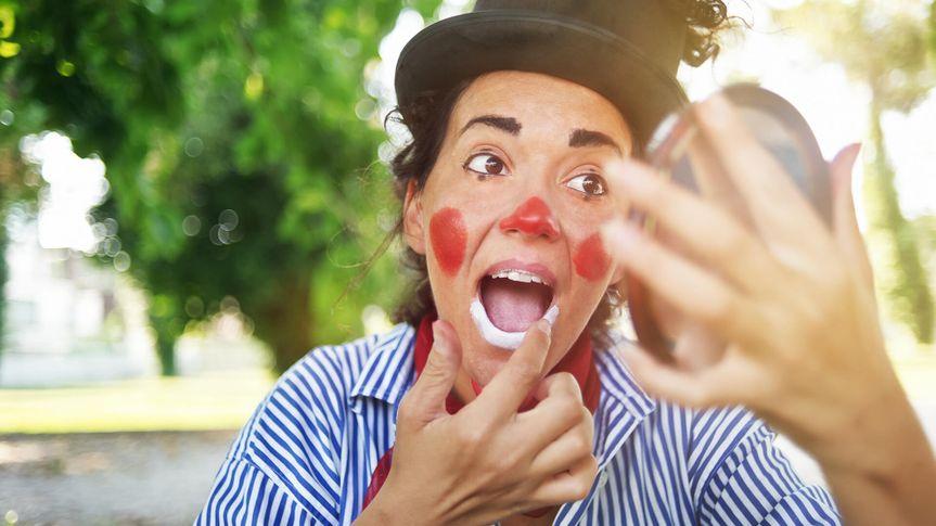 Professional female clown in makeup.