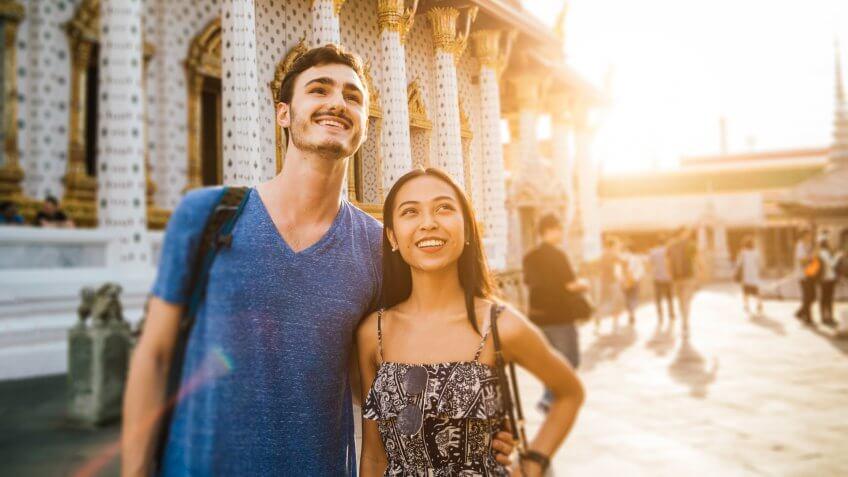 Young couple exploring a temple in Bangkok.