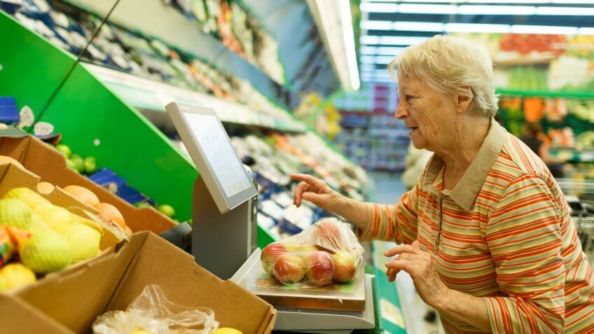 elderly woman purchasing fresh produce with SNAP