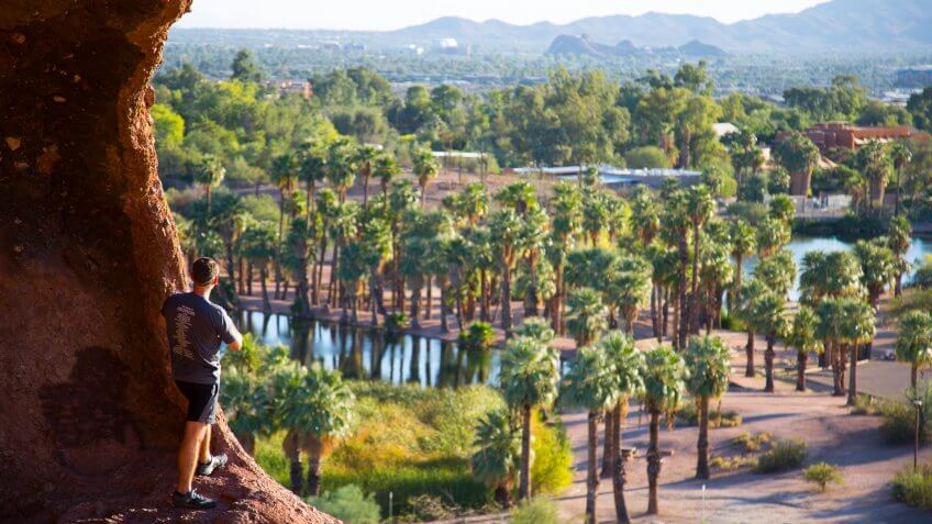 Guy looking the view from hole in the rock in Phoenix Arizona.