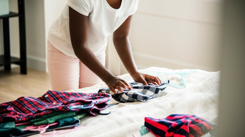 high school student folding her clothes