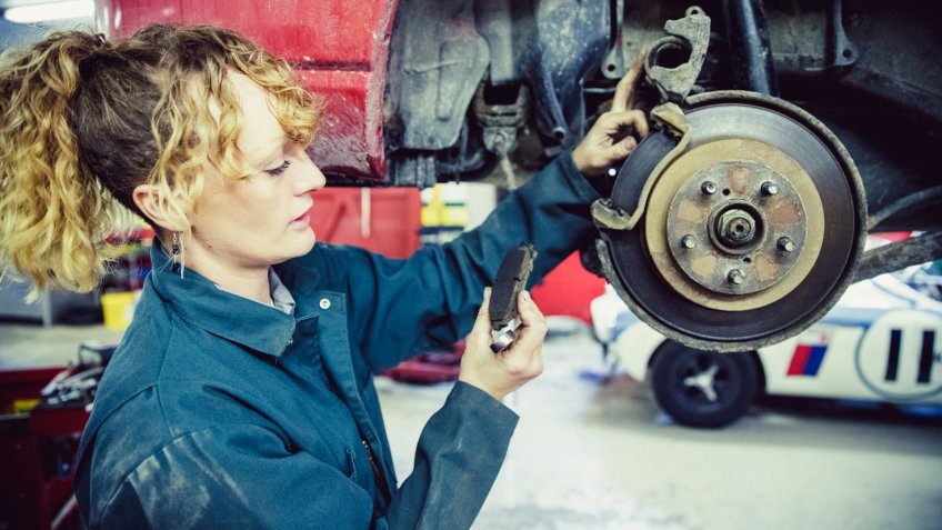 Brake Pad, Car, Repair, Mechanic, Safety, Rustic, Grease Monkey, Service - Female Mechanic Working at her Garage.
