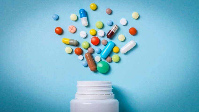 pharmaceutical medicine pill bottle with tablets and capsules