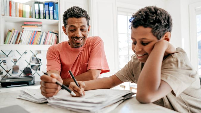 Dad helping his son with his homework.