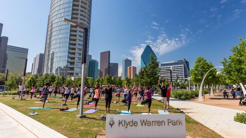 people practicing Yoga in Klyde Warren Park in Dallas Texas