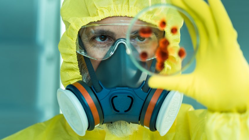 Man working with dangerous viruses in the laboratory.