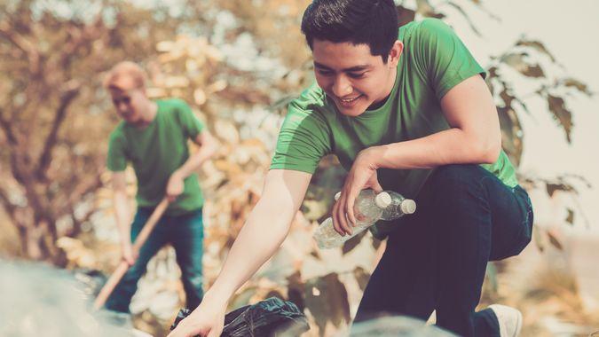 student volunteering to pick up trash