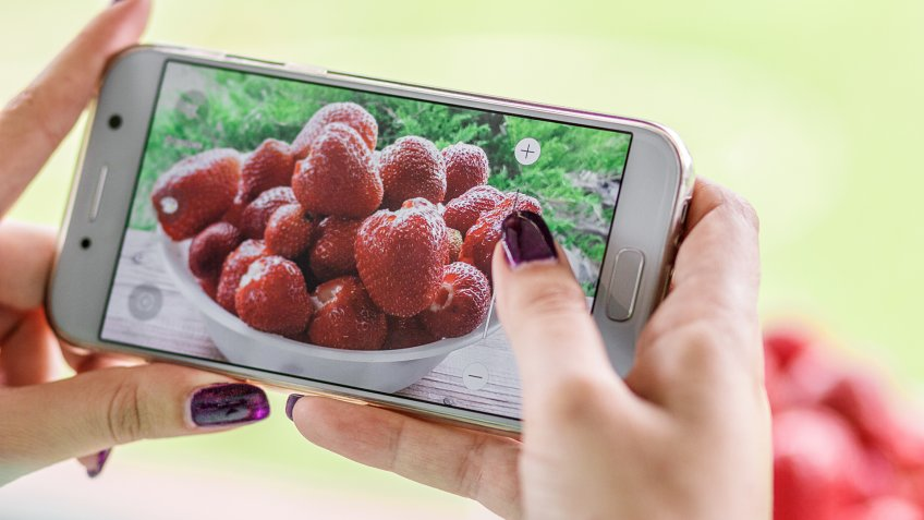 taking photos of strawberries with smartphone
