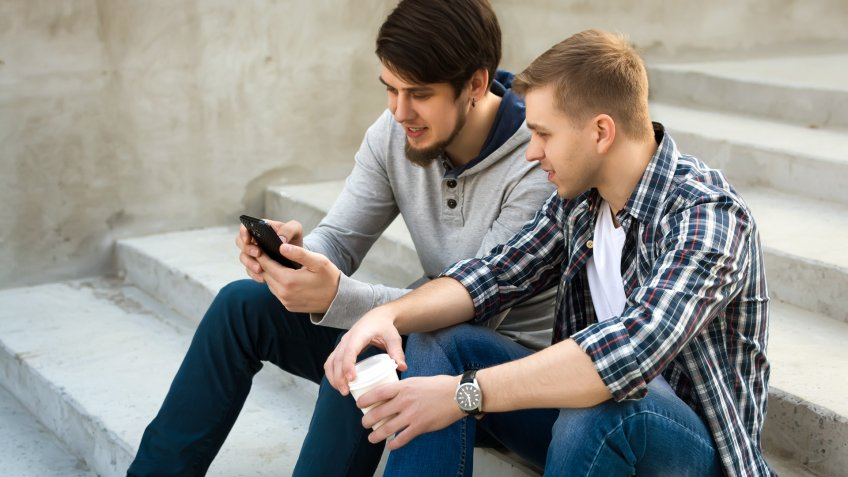 two guy friends talking about social media posts
