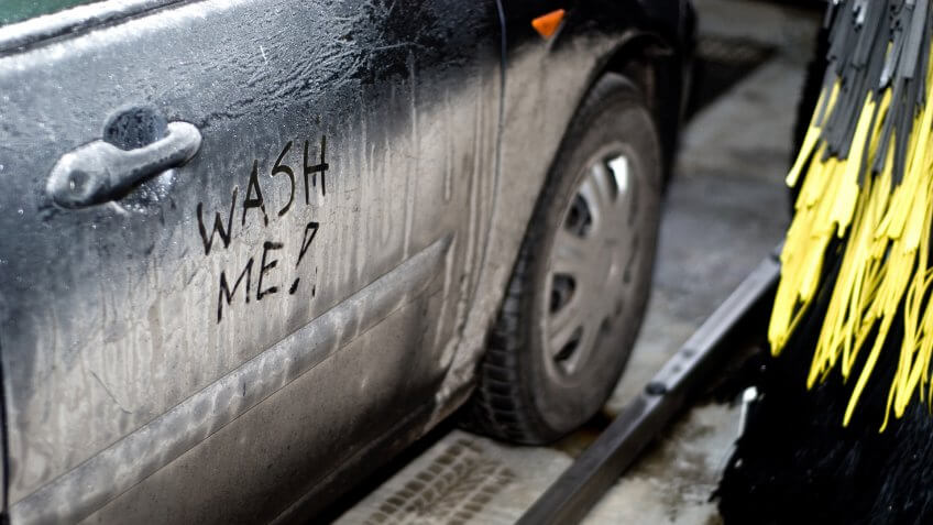 Interior of automatic car wash with dirty car (wash me sign) - Image.